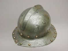 War Hat Date: 1450–1500 Culture: probably Italian Medium: Steel, copper alloy Dimensions: H. 7 1/8 in. (18.1 cm); L. 11 1/2 in. (29.2 cm); W. 10 3/8 in. (26.3 cm); Wt. 3 lb. 12 oz. (1701 g)