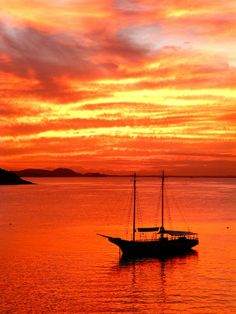 Take in a fiery red sunset in Buzios, Brazil.