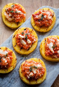 Grilled polenta bites with roasted red pepper, feta, and thyme are perfect for a party... or for a party of one!