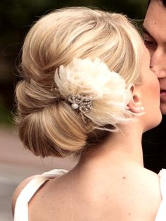 Bride's sleek chignon bun bridal hair Toni Kami Wedding Hairstyles ♥ ❷ Wedding hairstyle ideas  flower accent