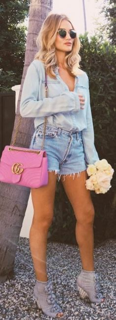 Who made Rosie Huntington-Whiteley's sunglasses, denim shorts, shirt, ankle boots, and button down shirt?