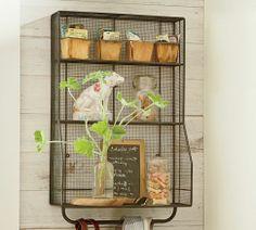 Wall-mounted steel-mesh storage shelves