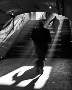 Photo: Sabine Weiss. 'Sortie de Metro' (Paris), 1955.