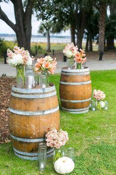 rustic outdoor wine barrel and peach flowers wedding alter / http://www.himisspuff.com/rustic-country-wine-barrel-wedding-ideas/3/