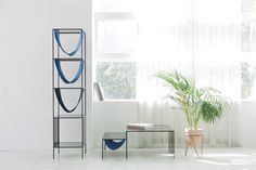 storage towers - Furniture storage towers often feature shelves that allow items to be placed horizontally, but the MbyM cabinet takes a different approach thanks t...