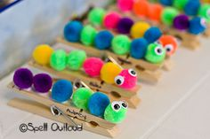 Pom Pom Caterpillars - the girls made these on popsicle sticks