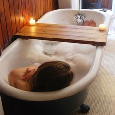 I'm going to take multiple hot baths today. wish i had this to accompnay me! Reclaimed Wood Tub Caddy