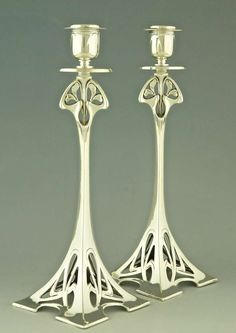 Pair of Silver Plated Art Nouveau Candlesticks by WMF, 1906 | From a unique collection of antique and modern sheffield and silverplate at https://www.1stdibs.com/furniture/dining-entertaining/sheffield-silverplate/
