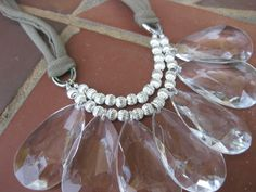 Large crystal teardrops with silver beads and jersey tie via Etsy.