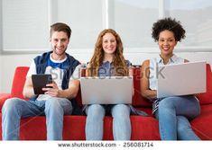 Creative Team Using Laptops Digital Tablet Arkivfoto (rediger nå) 256081714 Digital Tablet, Laptops, Sofa, Creative, Image, Settee, Couch, Laptop, Couches