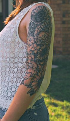 Black And Grey Ink Sunflower Tattoo On Waist photo - 1