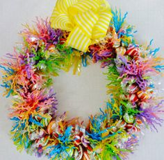 Spring is in the air! This hand made candy wreath provides a cheery decoration, great present, and conversation piece. Good for spring,