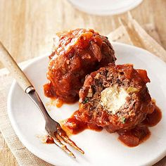 Crock Pot Meatballs with a Feta center! Great appetizer but how about on the side with a bowl of tomato soup?