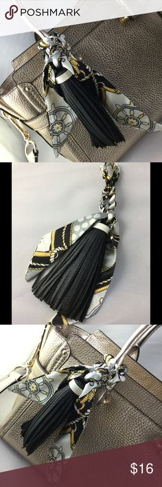 New Large Black Tassel & Scarf Purse Handbag Charm NWOT. Accessorize your handbag with this fantastic tassel/scarf combo! Black faux leather, paired with a silky print scarf. Just in time for Spring and Summer! Check out my other listings for more purse charms and handbag accessories. Bundle for a discount. I ship quick! Accessories