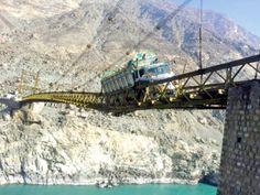 Alam Bridge, Pakistan Built with a combination of iron rods and wood over the Gilgit River, the Alam Bridge links Baltistan region to Gilgit and the rest of the country. It's about 300 metres in length. This wooden, wire suspension bridge over the Gilgit River was built by Chinese and Pakistani engineers in 1978. In view of its dangers, regional authorities are deployed at the bridge to ensure vehicles don't exceed the speed limit.