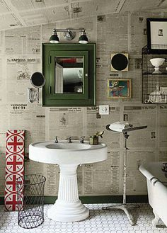Newspaper wallpaper bathroom with victorian feel. Love the pedestal sink and medicine cabinet. Newspaper Wall, Decor, Bathroom Decor Pictures, Newspaper Wallpaper, Home, Round Mirror Bathroom, Bathroom Design, Beautiful Bathrooms, Home Decor