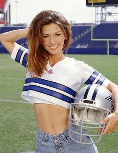 Shania Twain in jeans with a Dallas Cowboys helmet
