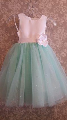 Mint green never looked cuter than on this flower girl dress! #MintGreenWeddingInspirations