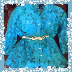 Turquoise Lace Button Up Top The color of this top is so pretty! Made by Susan graver. Hand wash cold. Like new condition. Would look really pretty with some white shorts or capris. Measures 22 pit to pit and 26 long could also fit a large tag says medium. Belt not included. Susan Graver Tops Blouses