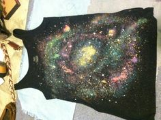 Galaxy shirt I made for NYE! DIY galaxy shirt. And it's super easy! Spray bleach. Colored fabric paint and white fabric paint for stars. I also added glitter.