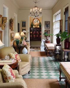 The entire sunroom was painted the same neutral color to effectively make the traditional art collection stand out. The Victorian floor tile is a focal point, so smaller sisal rugs were specified for the seating areas.