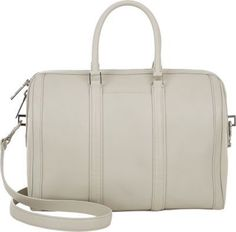 $895, White Leather Duffle Bag: A.L.C. Small Lucas Duffel White. Sold by Barneys New York. Click for more info: https://lookastic.com/women/shop_items/122923/redirect