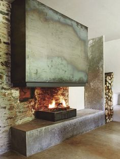 LOVE this fireplace. I wish there was a map of the world on the flue Metal Fireplace, Home Fireplace, Modern Fireplace, Fireplace Surrounds, Fireplace Design, Fireplace Mantels, Fireplaces, Interior And Exterior, Interior Design
