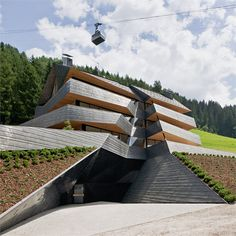 Built by PLASMA Studio in Sesto, Italy with date Images by Hertha Hurnaus. The building is located on a hillside in the Dolomites, at the end of a residential area. The volume has been develo. Architecture Cool, Cabinet D Architecture, Architecture Awards, Eco Construction, Design Exterior, Plasma, Free Hotel, South Tyrol, Luxury Hotels