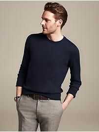 A fitted sweater and slacks can create a simple yet polished look.