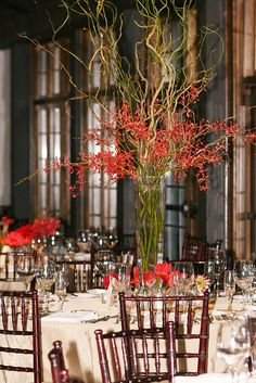 cd use as the tall centerpieces and put a few small vases of flowers and a bunch of votives