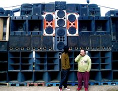 The sound system concept originated in the 1950s in Kingston, Jamaica. DJs would load up a truck with a generator, turntables, and huge speakers to set up street parties. The sound system scene is generally regarded as an important part of Jamaican cultural history and as being responsible for the rise of modern Jamaican musical styles such as ska, rocksteady, reggae and dub. When Jamaicans emigrated to the United Kingdom, the sound system culture followed and became rooted there in the…