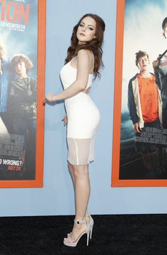 Elizabeth Gillies in a curve hugging white dress and sky high heels