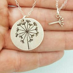 """The perfect gift for a mom who had her wish come true with a daughter! A pretty sterling silver set featuring a 3/4"""" disc with a deeply engraved dandelion and a"""