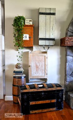 A funky wall cabinet gallery - hide the clutter in true salvaged style! via : www.funkyjunkinte... old trunks, vintage trunks, wall storage, rustic decor, storage cabinets, funky junk, old cabinets, cabinet storage, wall galleries