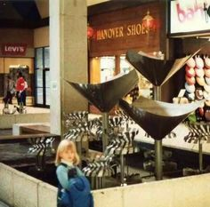 """Inside Long Ridge Mall, I so remember this and the tinking sounds those metal things that would spin, would make! And also going to the Levi store as a kid. Remember how Jordache jeans and how girls had to have them to be """"cool""""?"""