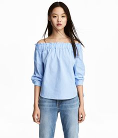 Check this out! Checked, off-the-shoulder blouse in airy, woven cotton fabric. Wide elastication and a small ruffle at top, 3/4-length sleeves with ties at cuffs, and a rounded hem. - Visit hm.com to see more.