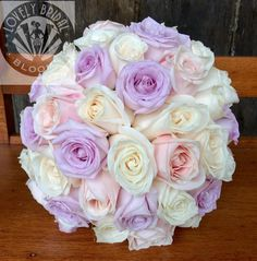 bouquet of lilac, soft pink and ivory roses