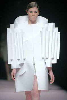 Alexandra Verschueren –  collection that revolved around the designer's medium, paper. Inspired by the work of artist Thomas Demand, she folded and cut the fabric in ways that remind paper. (Antwerp 2009)