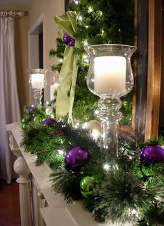 Green and purple with candles makes a beautiful Christmas Mantle Noel Christmas, Christmas Crafts, Green Christmas, Christmas Candle, Christmas Colors, Christmas Lights, Holiday Candles, Natural Christmas, Christmas Ornaments