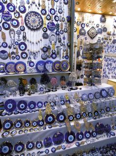 Blue Glass-Eye Pendant Shop in the Grand Bazaar, Istanbul, Turkey. They are mean… Blue Glass-Eye Pendant Shop in the Grand Bazaar, Istanbul, Turkey. They are meant to ward off evil spirits. Grand Bazaar Istanbul, Metal Lanterns, Turkey Travel, Turkey Europe, Thinking Day, Evil Eye Jewelry, Evil Spirits, Framed Artwork, Ankara