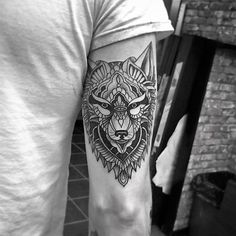 Lovely tribal wolf tattoo.