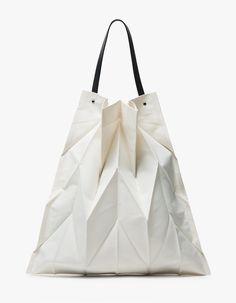 Modern, textured tote from Iittala in collaboration Issey Miyake in Ivory. Innovative pleating techniques add texture dimension. Black cowhide top handle attached with visible silver hardware. Roomy interior. Unlined. • Original Issey Miyake fabric she Mode Origami, Origami Bag, Oragami, Origami Paper, Fashion Bags, Fashion Accessories, Women's Fashion, Fashion Trends, Fashion Design