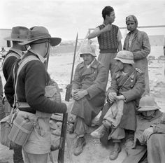 Men of the Australian 9th Infantry Division guard Italians and some of the first German prisoners to be taken during the war in North Africa, after Rommel's first unsuccessful assault on Tobruk.