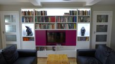 TV wall system - Here is an idea for hiding a TV behind sliding doors in this wall cabinet. Illuminated shelves and alcoves add interest. Living Room Style, Tv Wall Cabinets, Home Library Design, Living Room Designs, Wall Storage Unit, Bespoke Furniture, Glass Shelves In Bathroom, Wall Unit, Tv Wall Unit