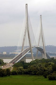 The Pont de Normandie is a cable-stayed road bridge that spans the river Seine linking Le Havre to Honfleur in Normandy, northern France