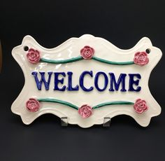 A personal favorite from my Etsy shop https://www.etsy.com/listing/484695193/handmade-pottery-handmade-welcome-plaque