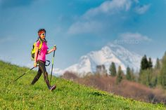 Young woman returning from a Nordic walking excursion by michelangeloop. Young woman returning from a Nordic walking excursion in the mountains in spring Nordic Walking, Cross Training, Young Women, South Africa, Exercise, Vacation, Adventure, Mountains, Woman