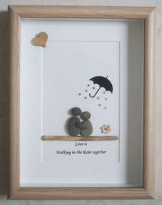 This is a beautiful small Pebble Art framed Picture of a Couple - Love is walking in the Rain together handmade by myself using Pebbles, Driftwood, White Heart and Fabric Flower Size of Picture incl Frame : approx. 22cm x 17cm Thanks for looking Doris Facebook: https://facebook.com/Pebbleartbyjewlls4u Product Code: P - Red
