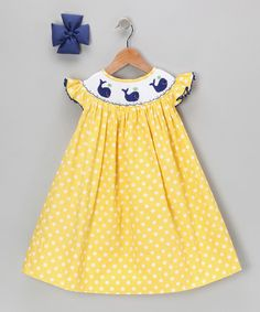 Boasting a light, breezy construction and back buttons, this timeless silhouette slips on for sweetness in seconds. Angel sleeves and smocking give it additional charm, while a coordinated bow finishes the look like a cherry on top!Includes dress and bow65% cotton / 35% polyesterMachine wash; hang dryImported