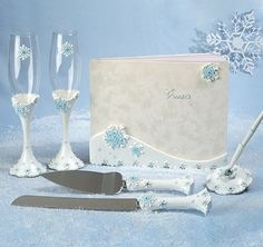 This magical Winter Wonderland Wedding Set is perfect for the bride and groom celebrating a winter or Christmas theme wedding.  Each piece has beautiful embossed winter white and blue snowflakes with sparkling crystals.  Set includes a guest book, pen set, toasting flutes and cake server.